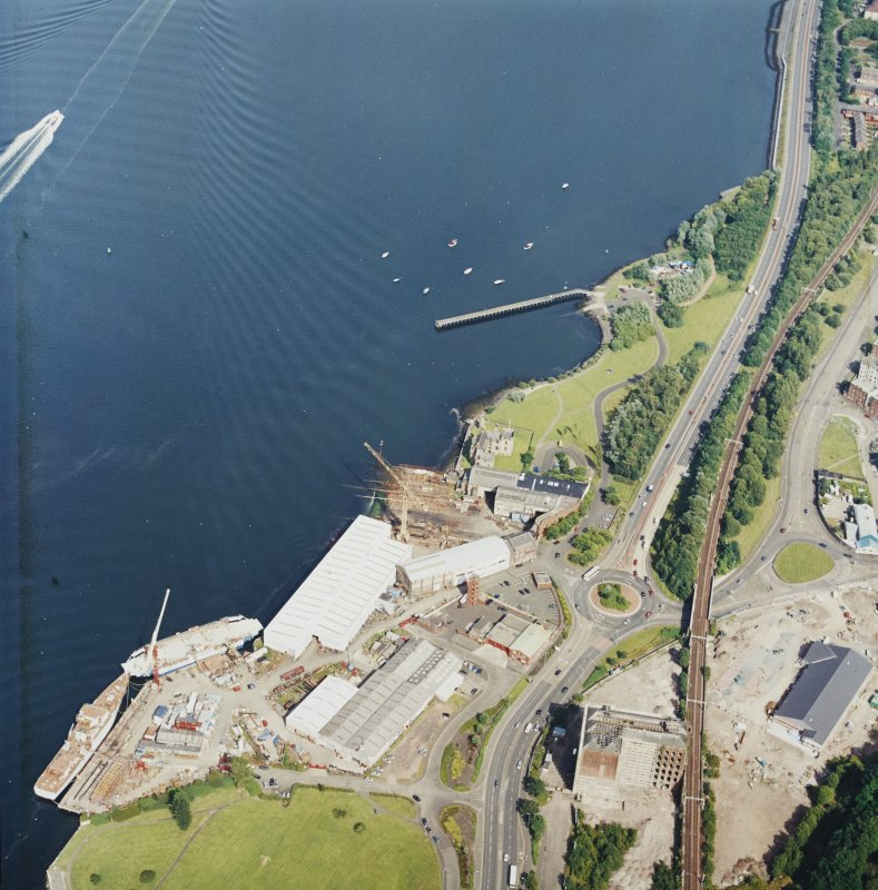 Oblique aerial view centred on the castle and shipyard, taken from the W.