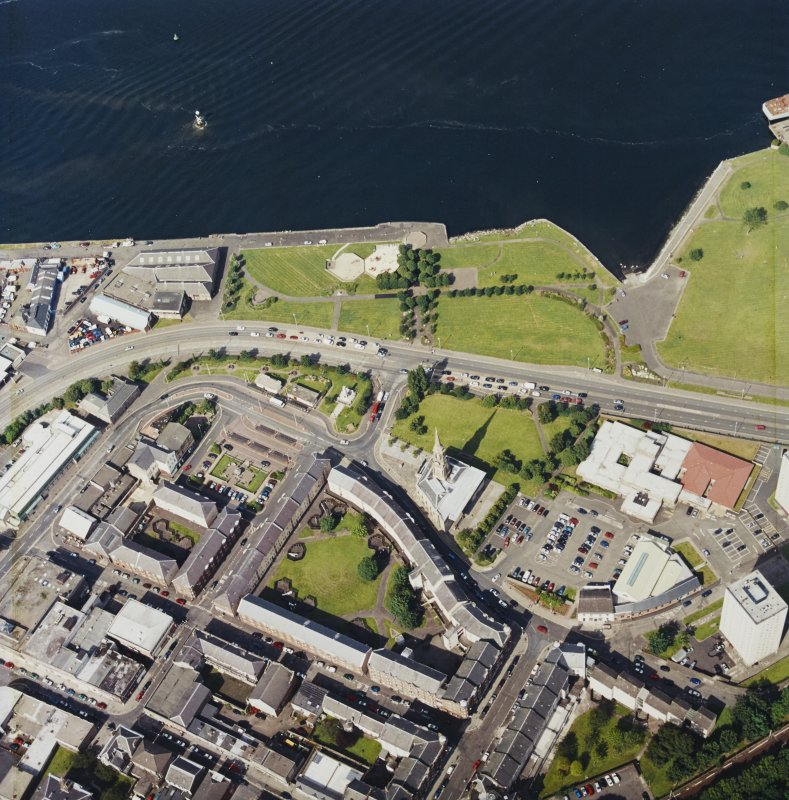 Oblique aerial view centred on the tolbooth and the quay, taken from the SW.