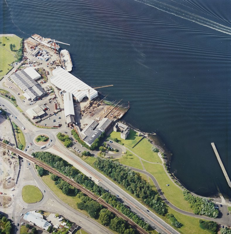 Oblique aerial view centred on the castle and shipyard, taken from the SE.