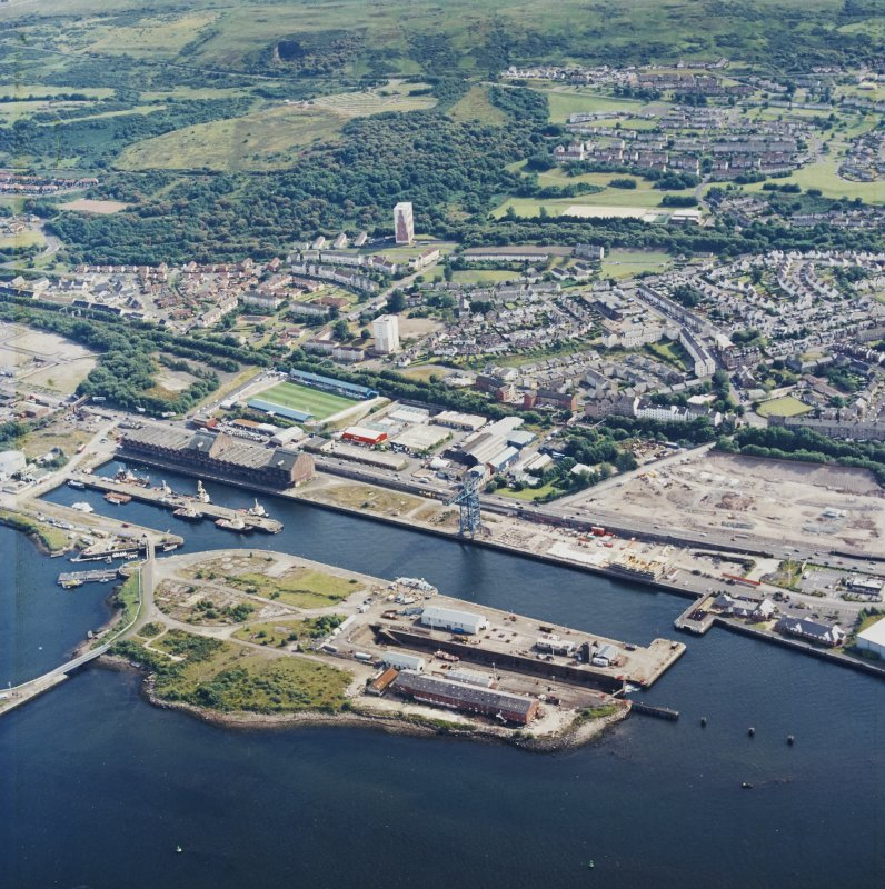 General oblique aerial view looking across the docks towards Greenock, taken from the N.
