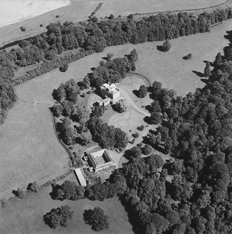 Oblique aerial view centred on the castle, tower-house and stables, taken from the WSW.
