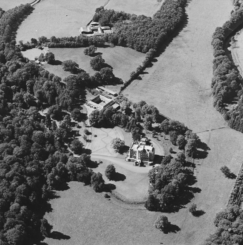 Oblique aerial view centred on the castle, tower-house and stables with the remains of rig adjacent, taken from the ESE.