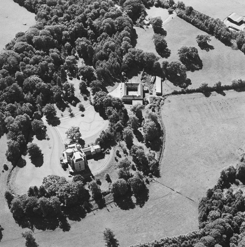 Oblique aerial view centred on the castle, tower-house and stables, taken from the NE.