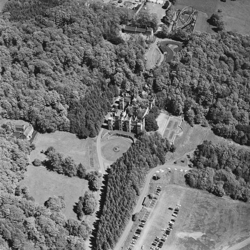 Aerial view of Loudoun Castle, gardens, estate policies and fairground, taken from the WSW.