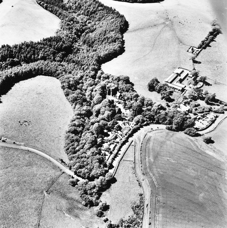 Oblique aerial view, taken from the ESE, centred on the tower-house.