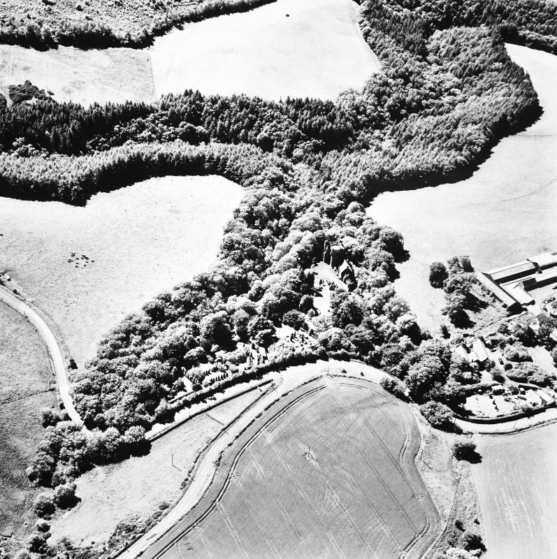 Oblique aerial view, taken from the East, centred on the tower-house.