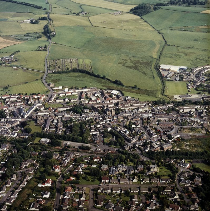 General oblique view centred on the town, taken from the NW.