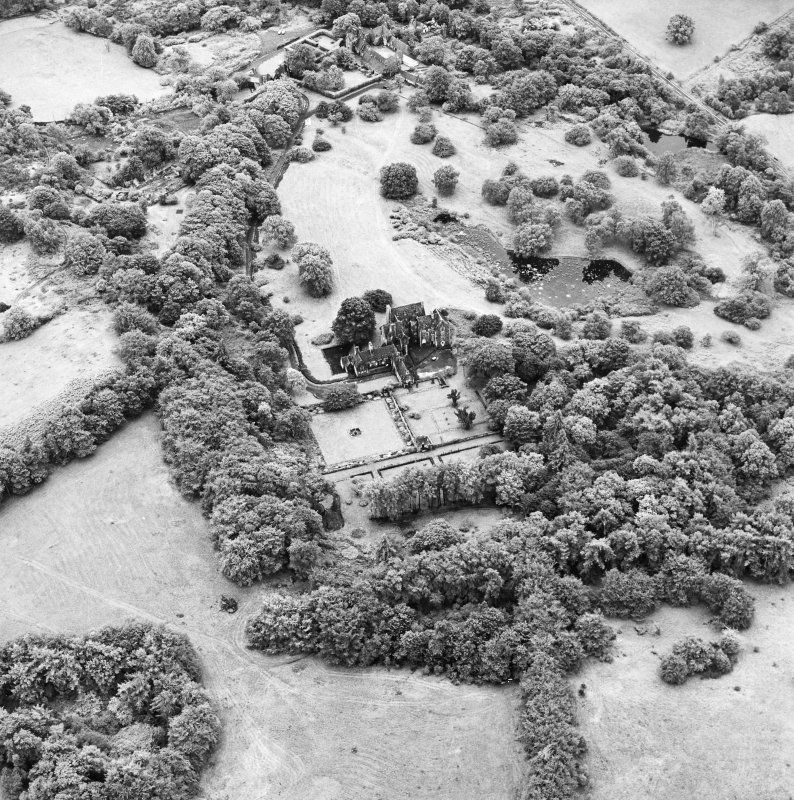 Formakin, oblique aerial view, taken from the N, showing Formakin House in the centre of the photograph, and Formakin Mill in the top centre.