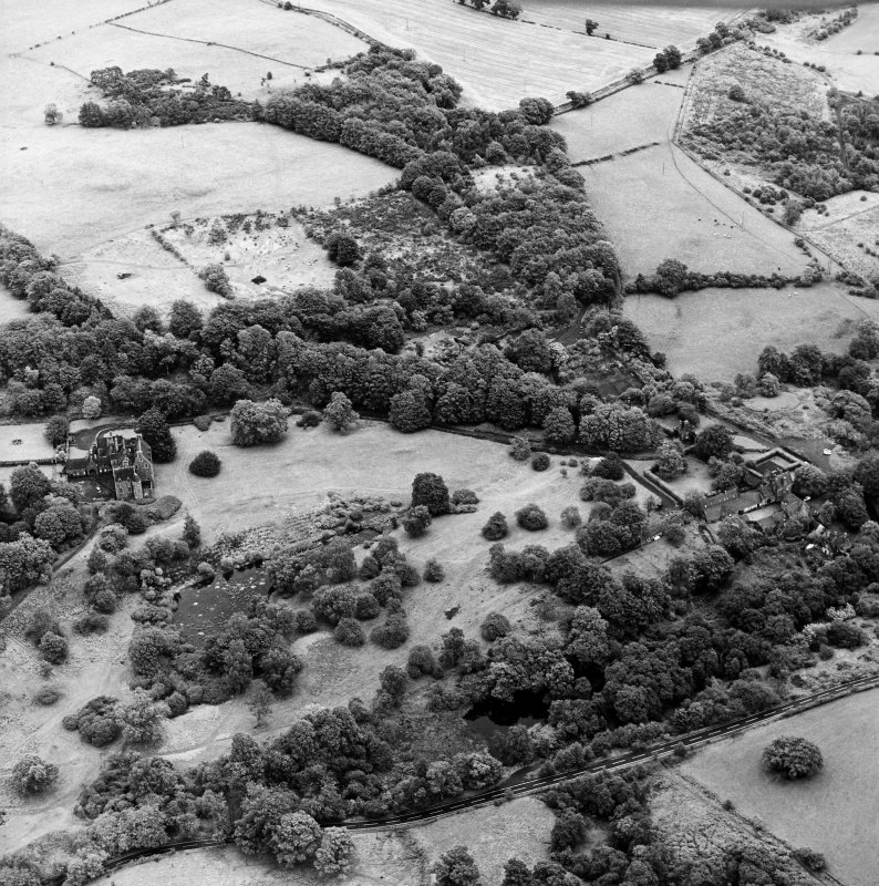 Formakin, oblique aerial view, taken from the NW, showing Formakin Mill, and out-buildings and the gatehouse of Formakin House in the centre right of the photograph, and Formakin House itself in the centre left.