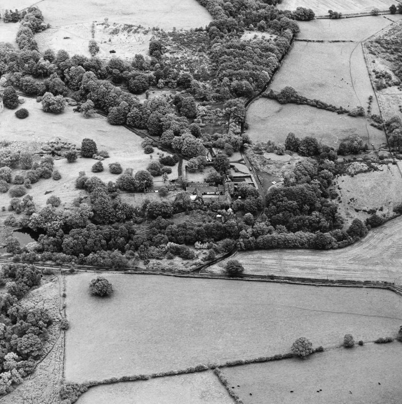 Formakin, oblique aerial view, taken from the WSW, centred on Formakin Mill and out-buildings of Formakin House.