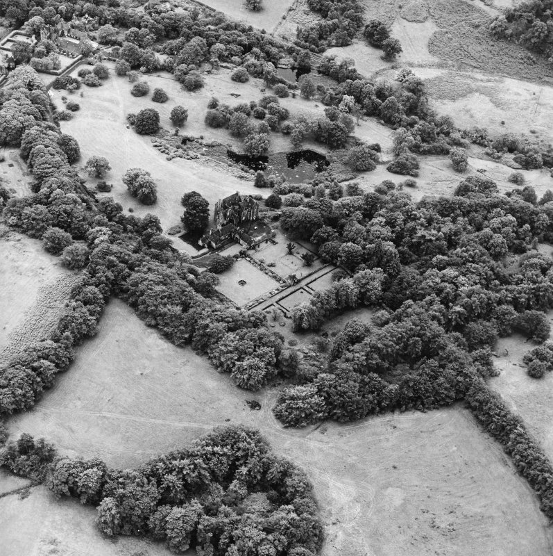 Formakin, oblique aerial view, taken from the NE, centred on Formakin House. Formakin Mill, and out-buildings of Formakin House, are visible in the top left-hand corner of the photograph.