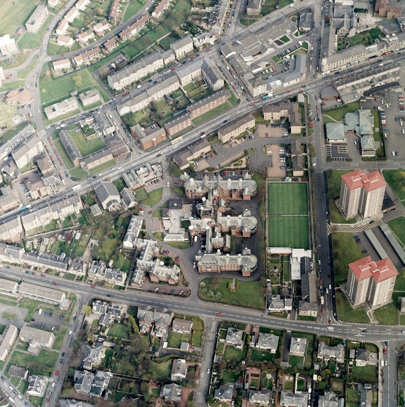 Oblique aerial view centred on the hospital and churches, taken from the WNW.