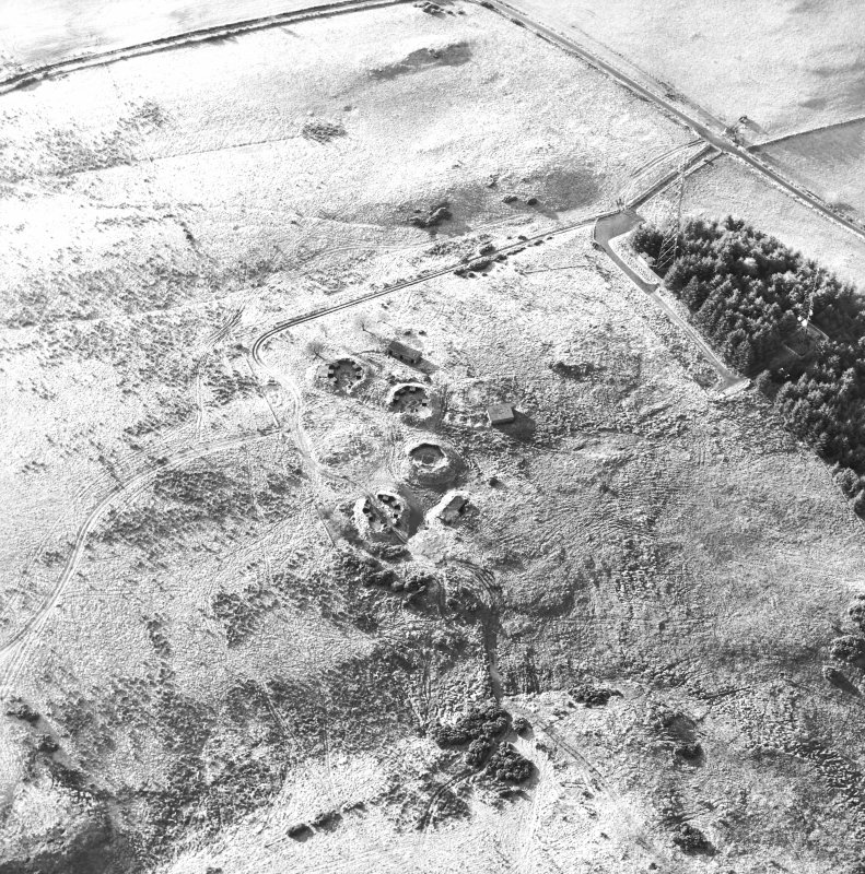 Oblique aerial view centred on the remains of the anti-aircraft battery with traces of the camp adjacent, taken from the NE.