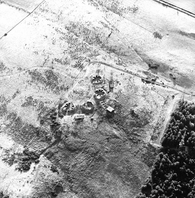 Oblique aerial view centred on the remains of the anti-aircraft battery with traces of the camp adjacent, taken from the N.