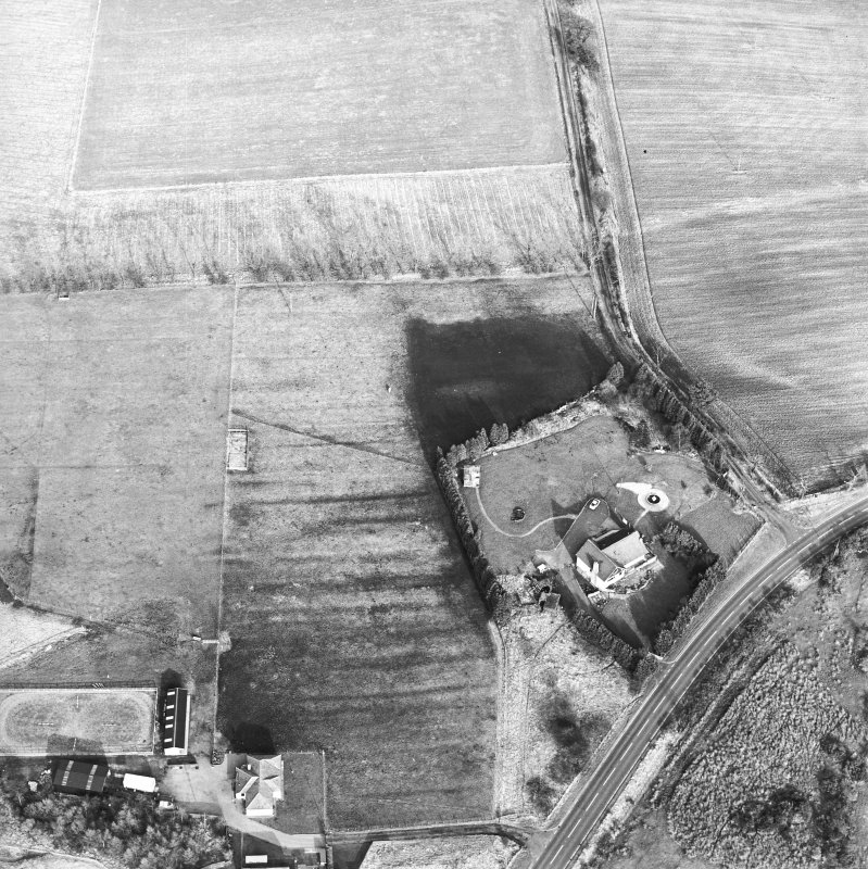 Oblique aerial view centred on the remains of an anti-aircraft battery, taken from the W.