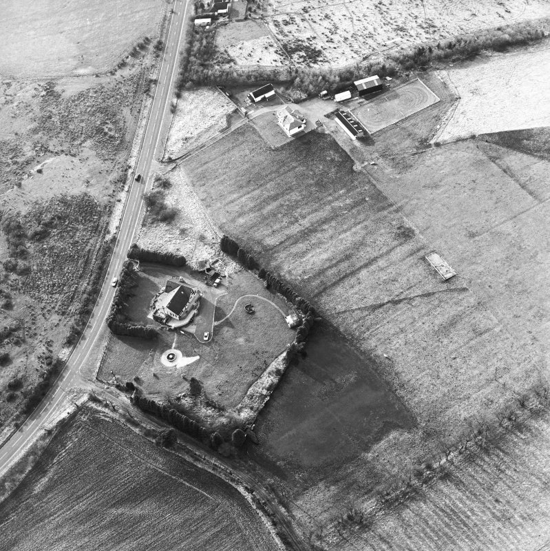 Oblique aerial view centred on the remains of an anti-aircraft battery, taken from the ESE.