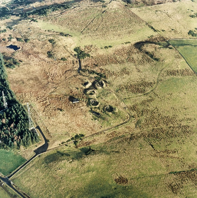 Oblique aerial view centred on the remains of the anti-aircraft battery with traces of the camp adjacent, taken from the WSW.