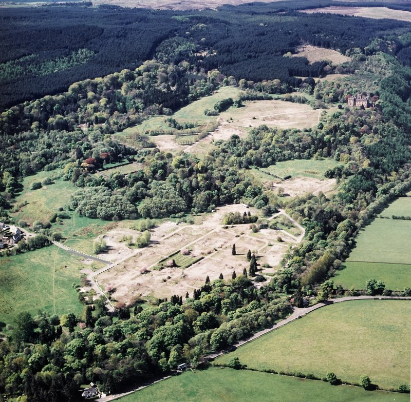 General oblique aerial view centred on the site of the hospital after the demolition of most buildings, taken from the NE.