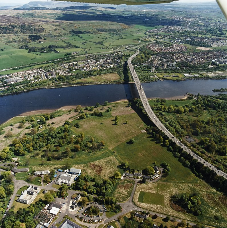 General oblique aerial view looking across the cottages and bridge towards Old Kilpatrick and Clydebank, taken from the WSW.