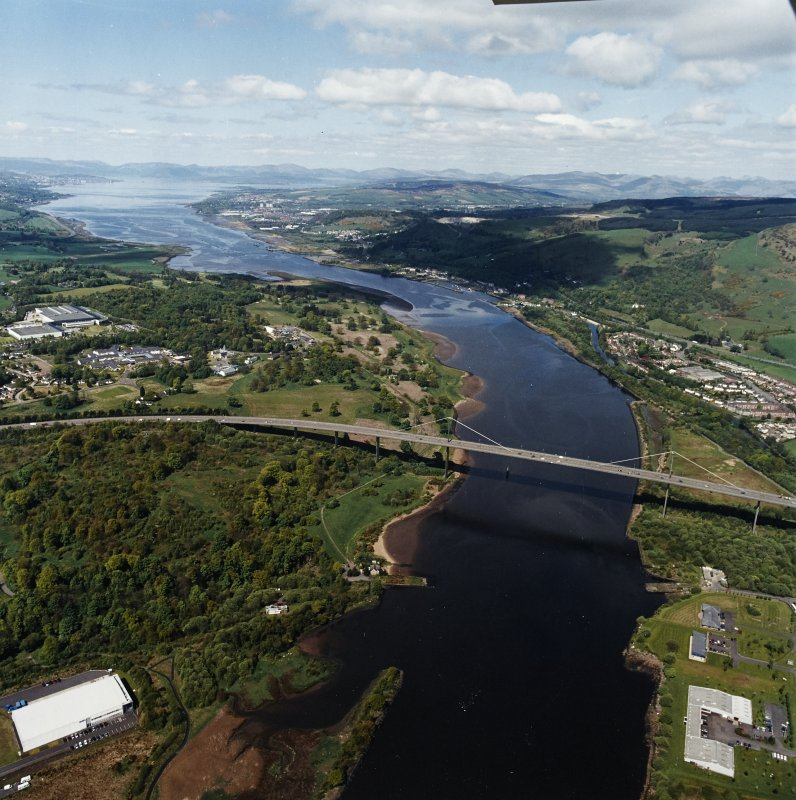 General oblique aerial view looking across the bridge and hospital along the River Clyde towards Dumbarton, Greenock and the Firth of Clyde, taken from the SE.