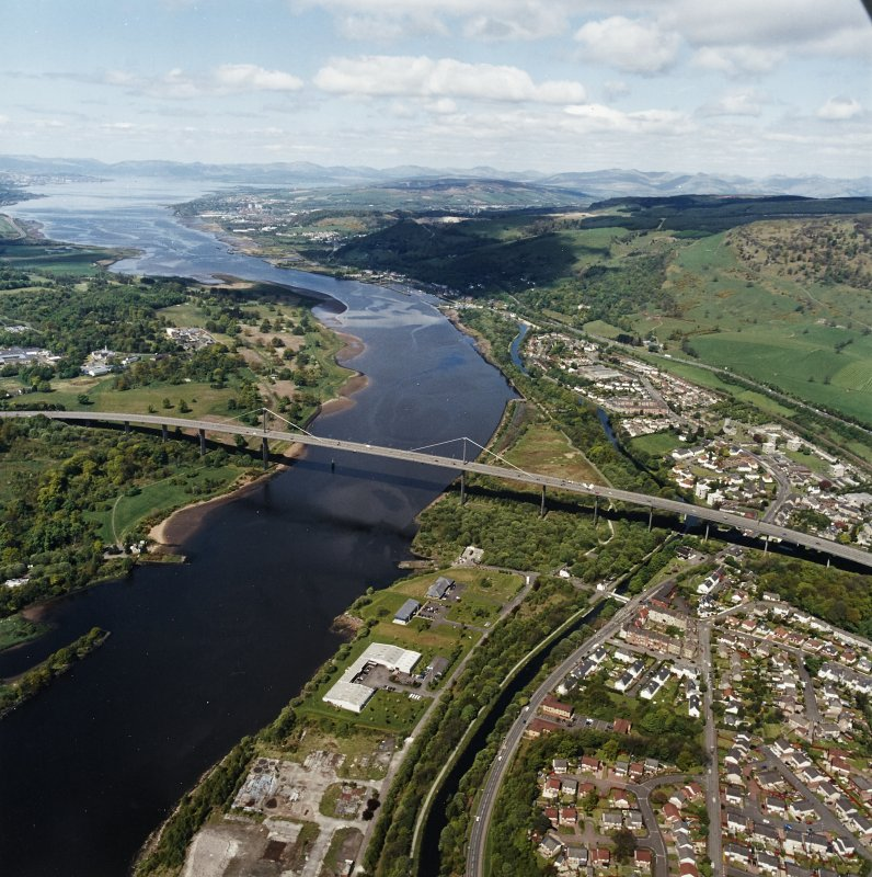 General oblique aerial view looking across the bridge and canal, Clydebank and Old Kilpatrick, along the River Clyde towards Dumbarton, Greenock and the Firth of Clyde, taken from the SE.