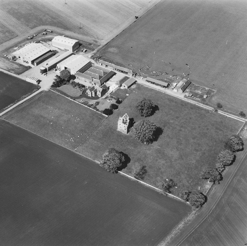 Oblique view from S with farm buildings.