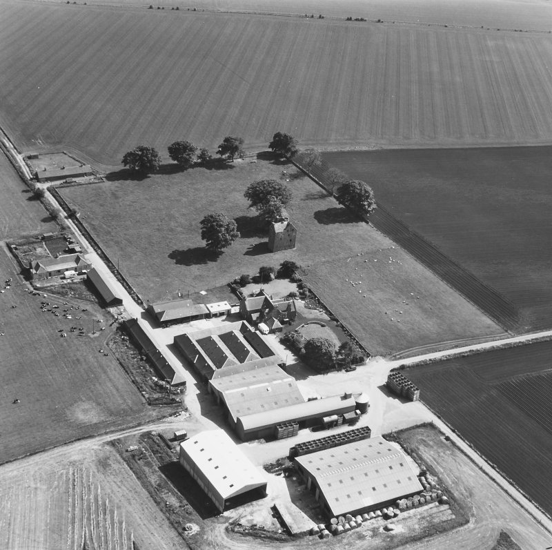 Oblique aerial photograph from SW with farm buildings.