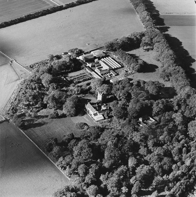 Oblique aerial view of the tower-house, country house, farmsteading and horsemill, taken from the ESE.