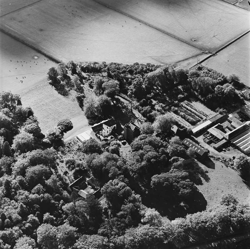 Oblique aerial view of the tower-house, country house, farmsteading and horsemill, taken from the NNE.