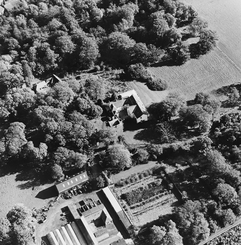 Oblique aerial view of the tower-house, country house, farmsteading and horsemill, taken from the NW.