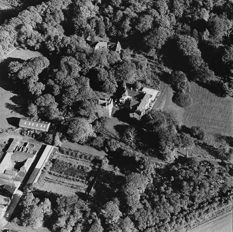 Oblique aerial view of the tower-house, country house, farmsteading and horsemill, taken from the WSW.