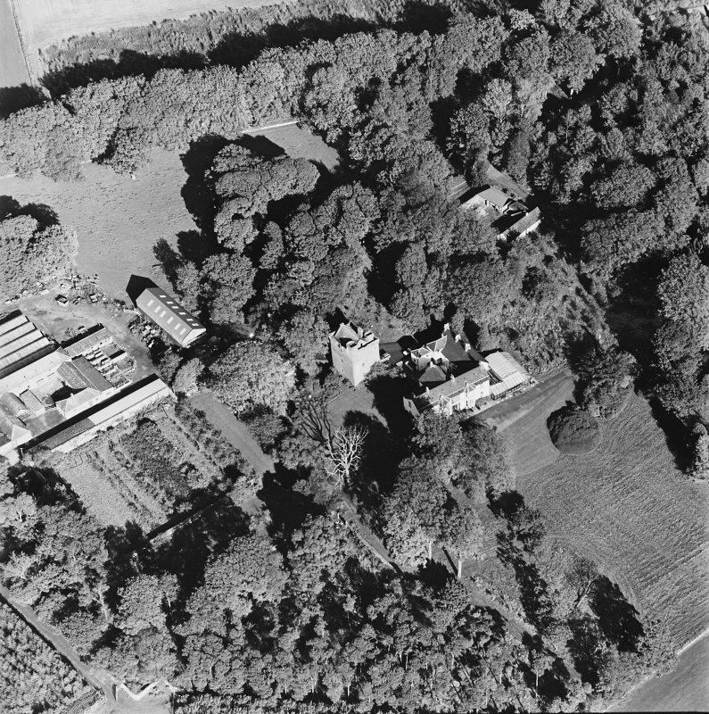 Oblique aerial view of the tower-house, country house, farmsteading and horsemill, taken from the SW.