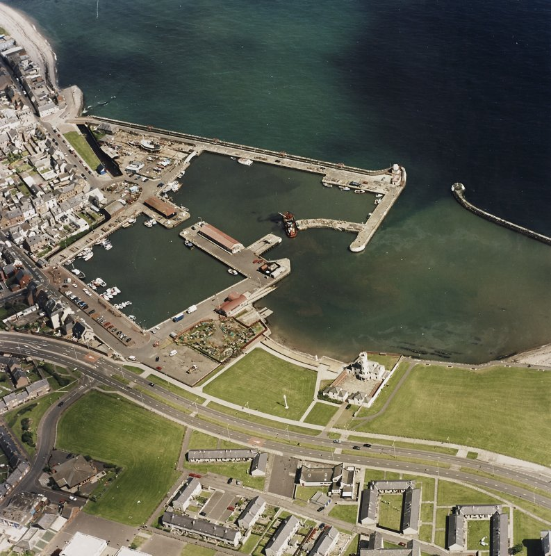 Oblique aerial view centred on the harbour and signal station, taken from the WNW.
