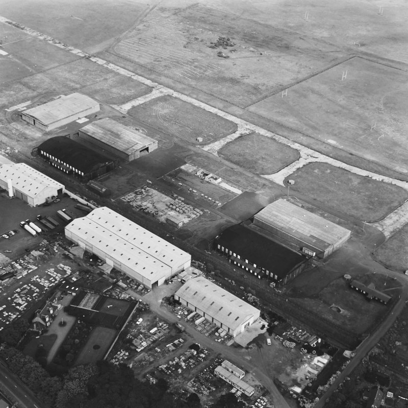 Oblique aerial view centred on the aircraft hangars, taken from the SW.