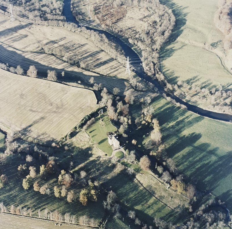 Oblique aerial view centred on the tower-house, taken from the SE.