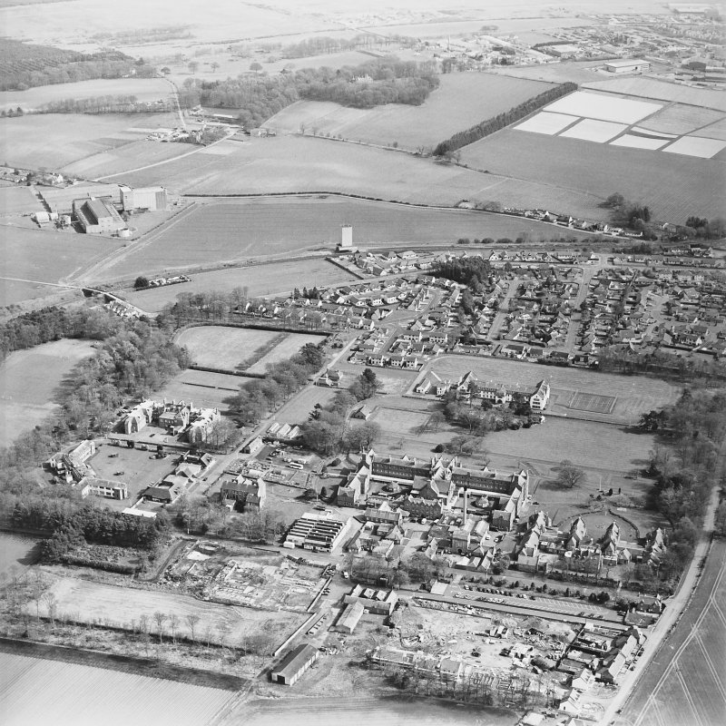 General oblique aerial view of the hospitals with the distillery adjacent, taken from the NW.