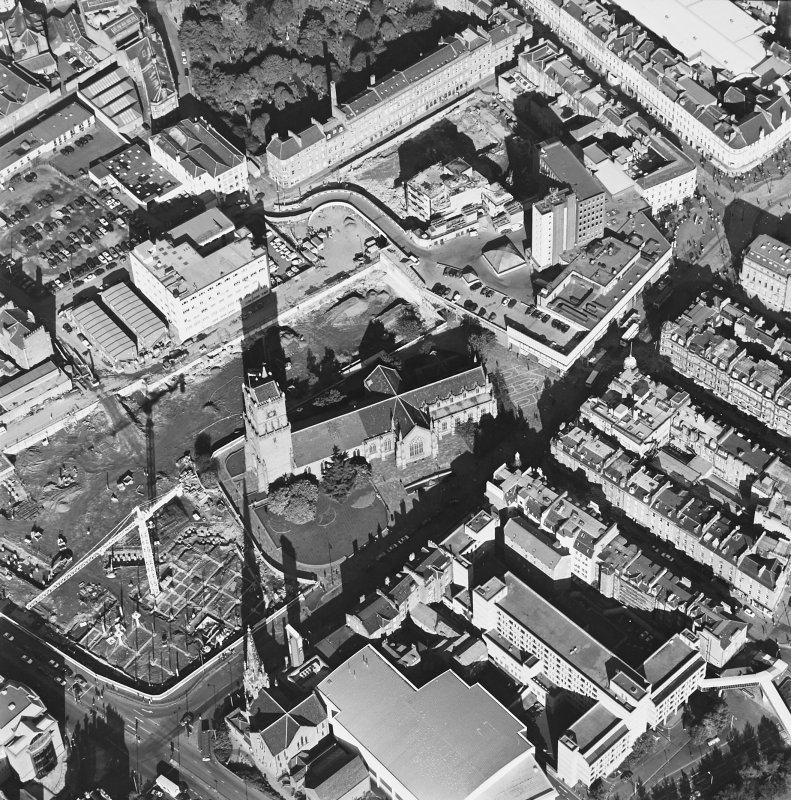 Oblique aerial view centred on the churches and adjacent construction, taken from the S.