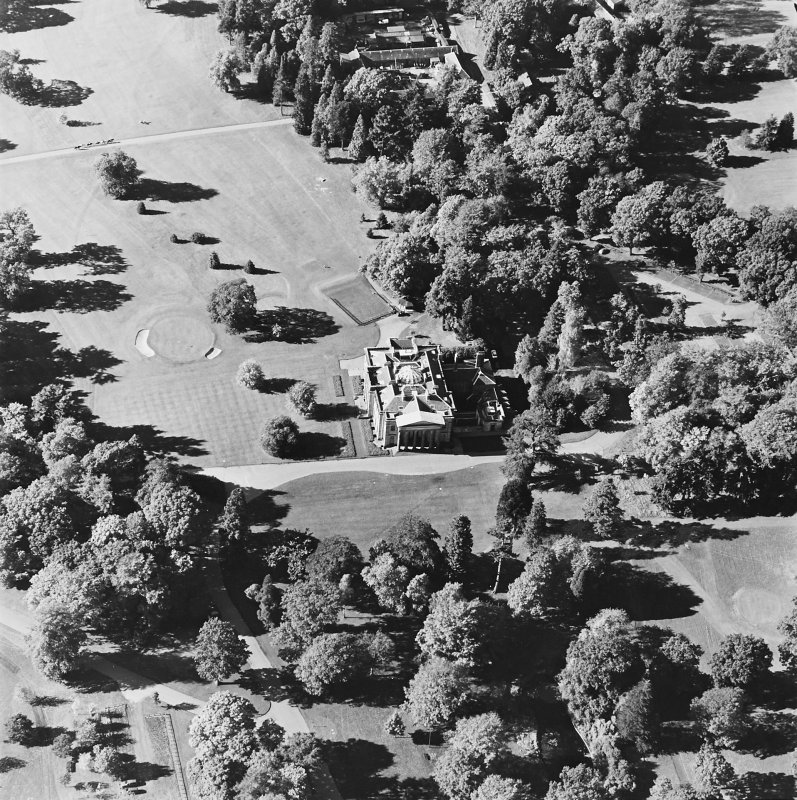 Oblique aerial view centred on the country house, taken from the E.