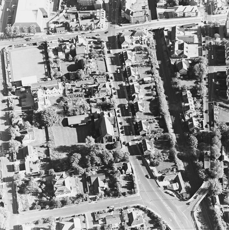 Oblique aerial view centred on the church, taken from the W.