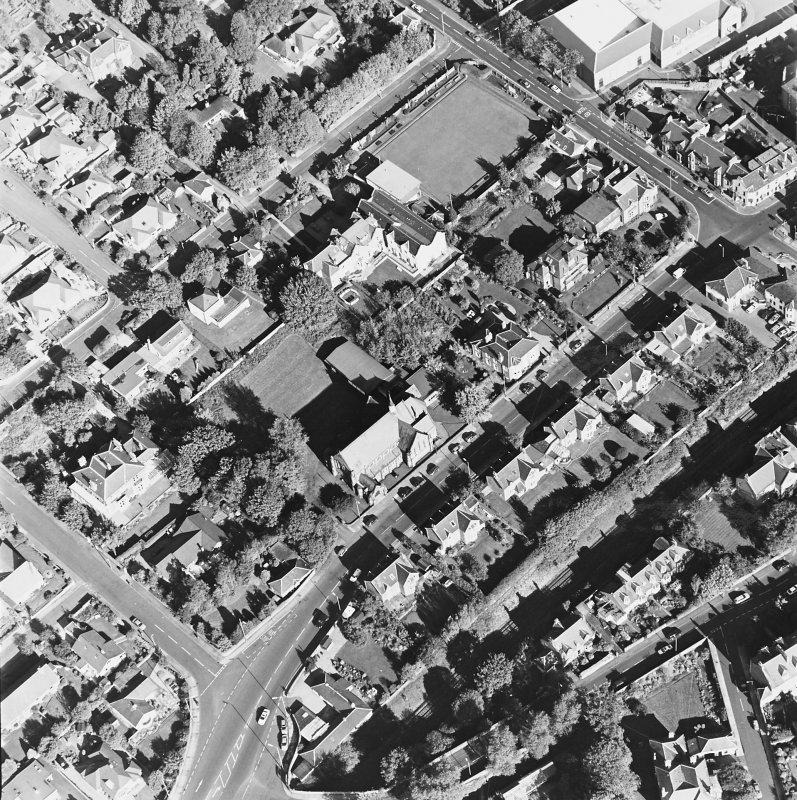 Oblique aerial view centred on the church, taken from the SW.