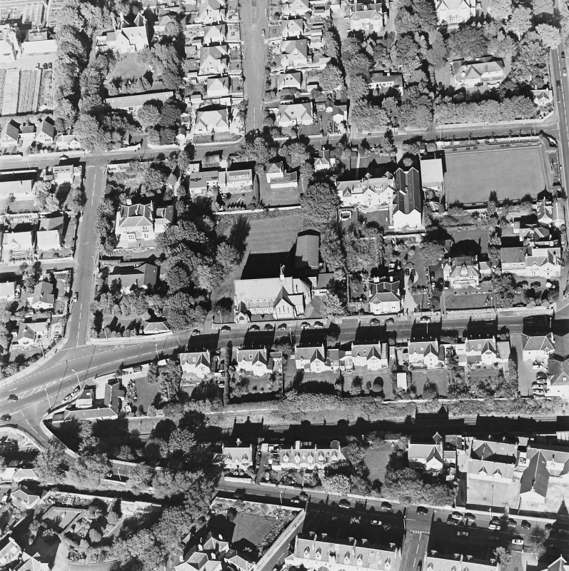 Oblique aerial view centred on the church, taken from the S.