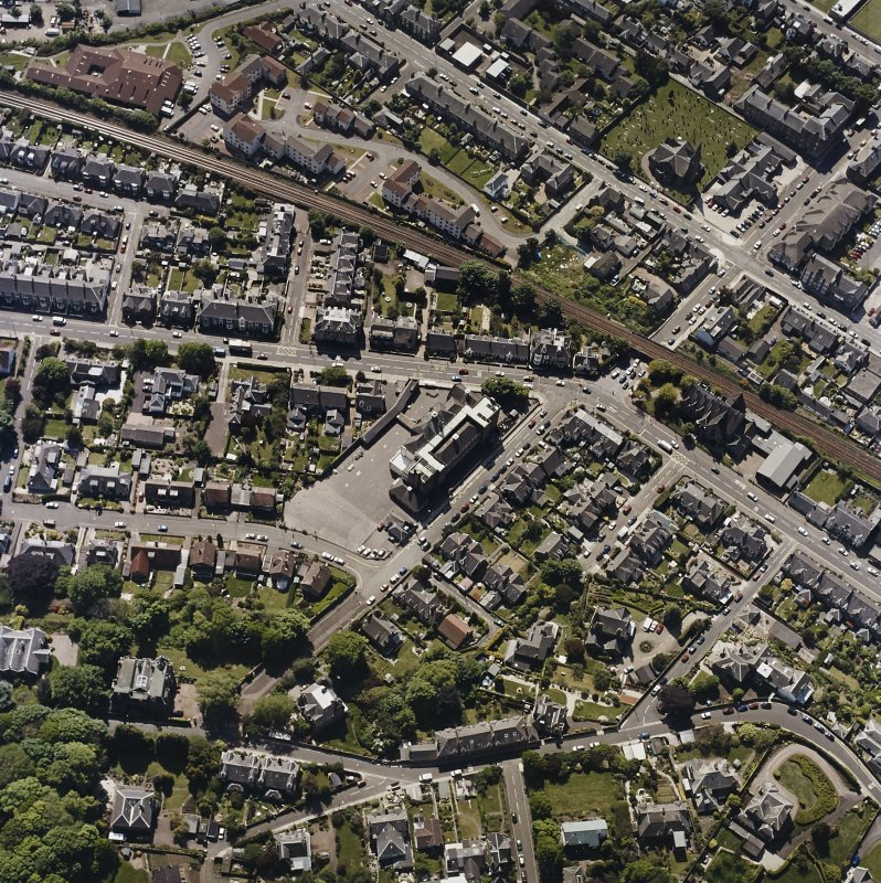Oblique aerial view of Broughty Ferry centred on the school, taken from the NNW.