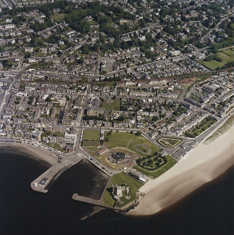 General oblique aerial view of Broughty Ferry centred on the school with the castle and harbour adjacent, taken from the SSW.