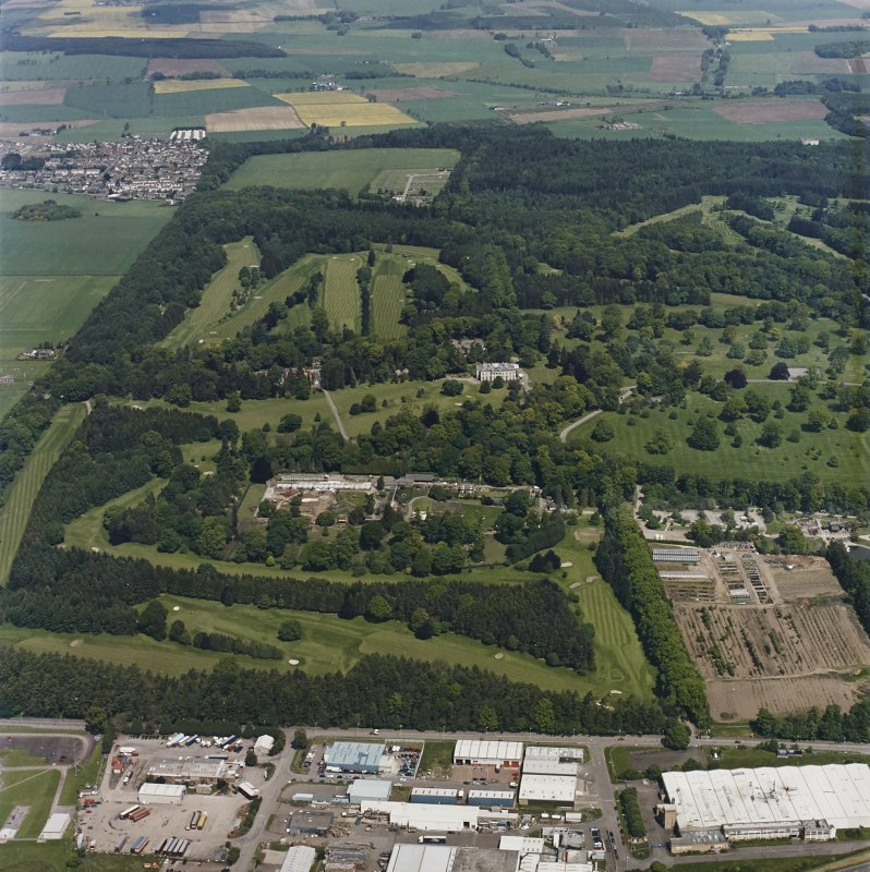 Oblique aerial view of Camperdown Park centred on the country house with the walled garden and glasshouses adjacent, taken from the S.