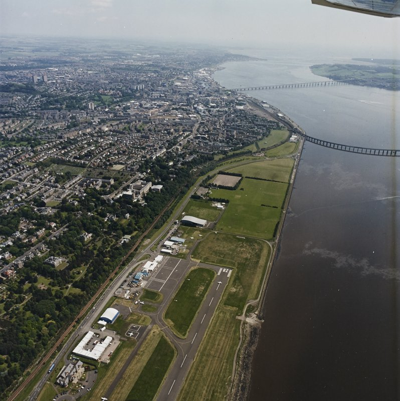 General oblique aerial view of Dundee, the bridges and the airport, taken from the WSW.