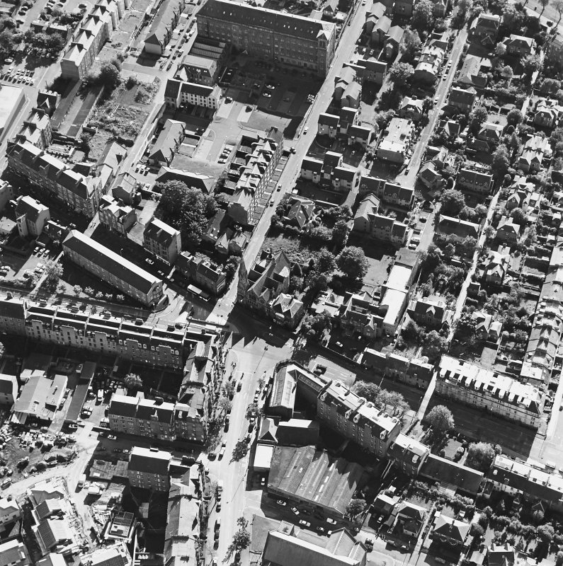 General oblique aerial view centred on the church, taken from the NNW.