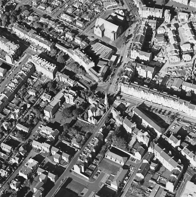 Oblique aerial view centred on the churches, taken from the SE.