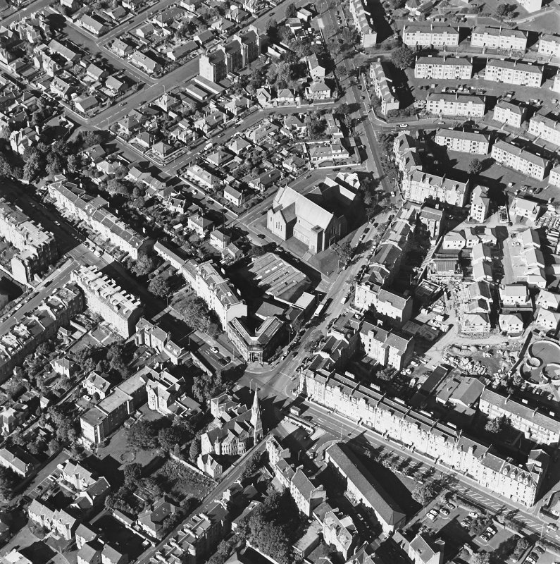 Oblique aerial view centred on the churches and Blackness Avenue, taken from the SE.
