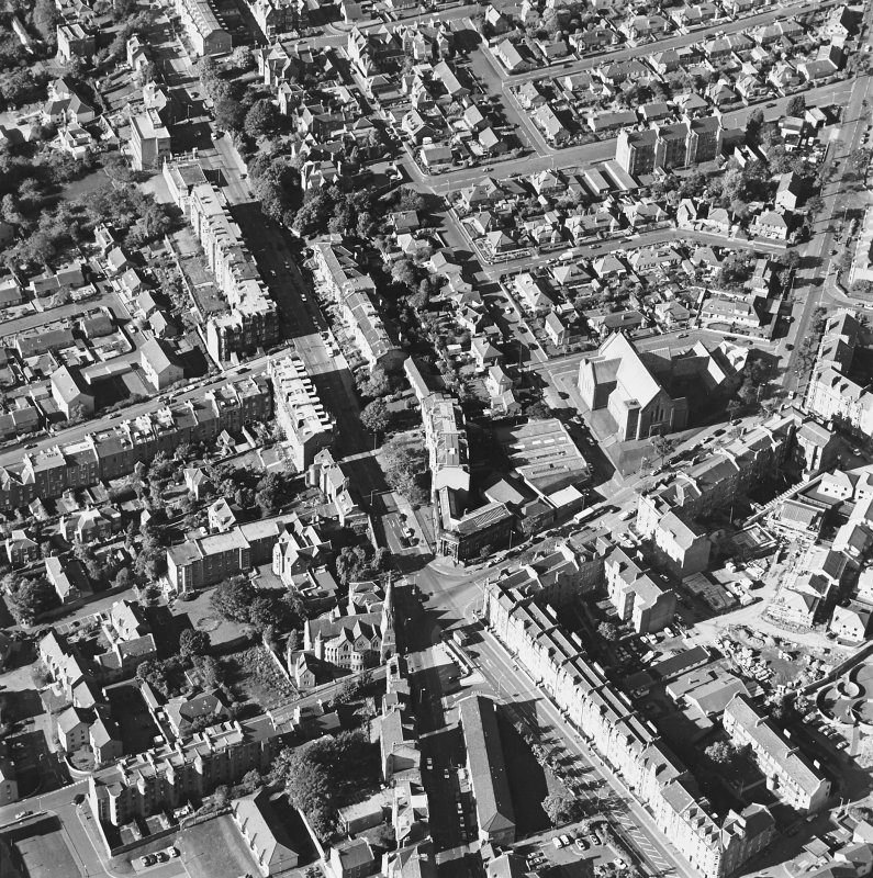 Oblique aerial view centred on the churches, Blackness Avenue and Perth Road, taken from the .