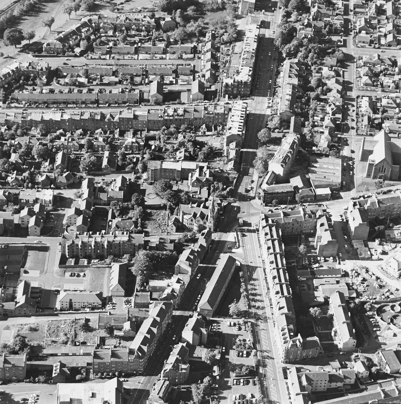 Oblique aerial view centred on the churches and Perth Road, taken from the E.